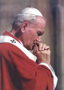 Pope John Paul II In Prayer.jpg