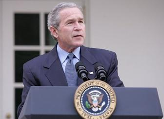 President George W. Bush is seen in the Rose Garden of the White House, Friday, Dec. 2, 2005, as he speaks on the growth of the economy with news of 215,000 jobs added for the month of November and third-quarter growth this year was 4.3 percent. White House photo by Paul Morse
