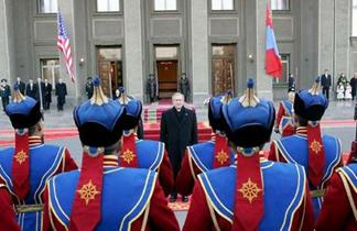 Meeting of warriors: President Bush stops to review troops of the Mongolian Honour Guard upon his arrival in the capital Ulan Bator.