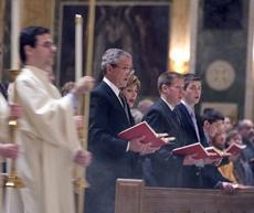 Presidentgeorge w bush and mrs laura bush attend mass at the